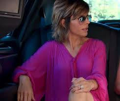 lisa rinna blonde hair lisa rinna s pink boho dress blue sunglasses big blonde hair