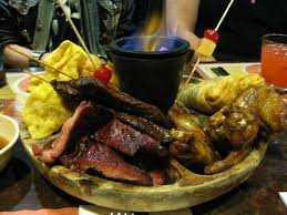 poo poo platters pu pu platter served style with a burning blue to
