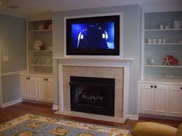 corner gas fireplace with tv above google search