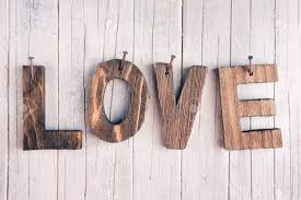 the word u0027love u0027 in wooden letters nailed on a rustic wooden