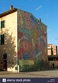 american graffiti on italian wall murals on wall amercaon art wall large colorful mural by world famous us graffiti artist keith haring on the side of a