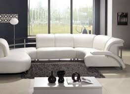 white sofas in loft conversion living room with a white carpet and
