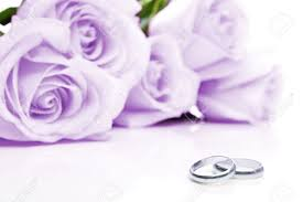 white gold and purple wedding two wedding rings made of white gold and purple roses in