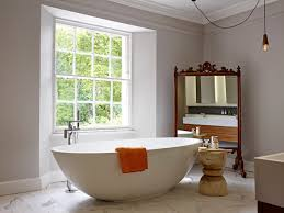 this white contemporary freestanding bath is positioned to enjoy
