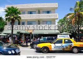 bright yellow art deco car garage miami florida stock photo