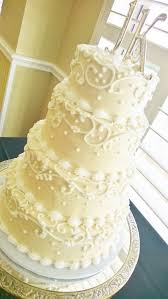 white piped scroll cream cheese frosting wedding cake