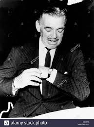 clark gable actor clark gable adjusts his watch stock photo royalty free