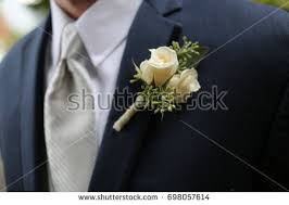 white boutonniere groom blue suit white boutonniere stock photo 698057614