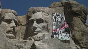 mt rushmore obama on mt rushmore greenpeace banner calls for global warming