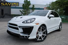 teal car white rims cayenne savini wheels