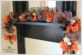 mesh ribbon ideas uses a six foot lighted christmas garland for the foundation of