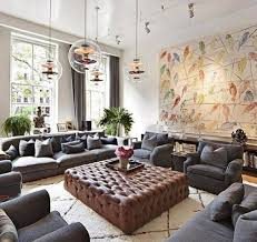 big living room with large ottoman as coffee table and grey