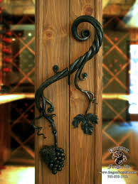 forged wine cellar door pull with forged grapes