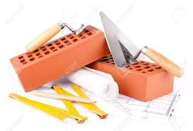 mason tools bricks and house construction plans stock photo