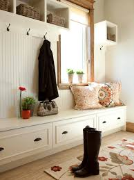 custom built in mudroom cubby design with hooks under wall mounted