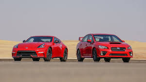 red nissan car shootout nissan 370z nismo vs subaru wrx sti roadshow