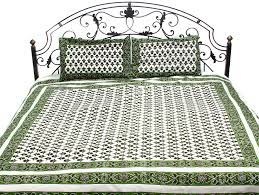 ivory and green bedspread from pilkhuwa with printed flowers all over