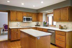 oak cabinet kitchen color ideas with white granite island