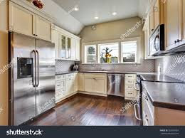soft beige kitchen cabinets builtin stainless stock photo