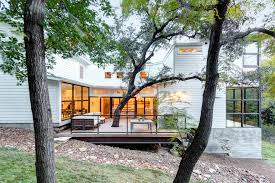 rotating tree stand in exterior transitional with building on
