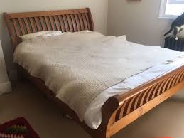 very strong solid wood king size bed frame 5ft very good condition