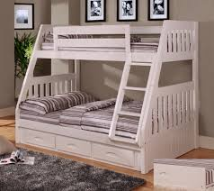 white wooden bunk bed having striped bedding bed with white wooden