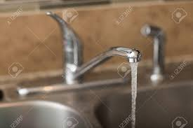 water coming up from sink water coming out of a faucet view is a 3 4 view with shallow