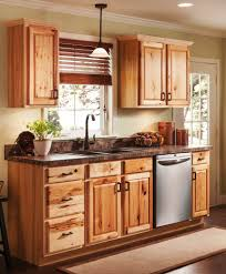 limestone countertops unfinished wood kitchen cabinets lighting