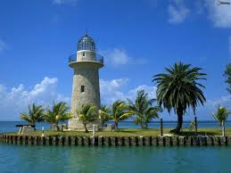 lighthouse palm trees sea 212688 jpg