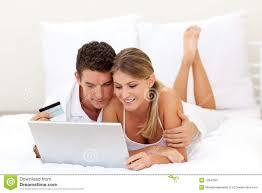 smiling couple shopping online stock image image 12641961