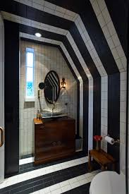 black and white bathroom design with floor tile to the ceiling