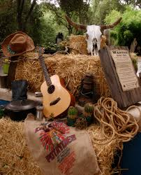 western theme must haves guitar cowboy hats sacks hay