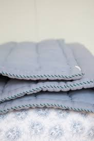 hand quilted cotton blanket in colour chambray by camomile london