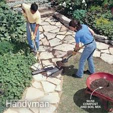 How To Lay Flagstone Patio How To Make A Path Of Building For A Stone Path Family Handyman