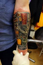 incredible biomechanical tattoo on forearm