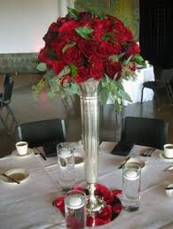 Trumpet Vase Wedding Centerpieces by Trumpet Vases But Red Roses With Bling On Top Of Black Vases