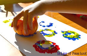 painting with pumpkins in lieu of preschool