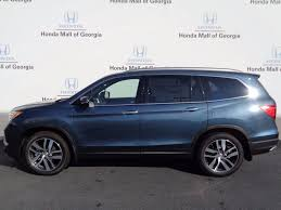 2017 new honda pilot touring 2wd at honda mall of georgia serving