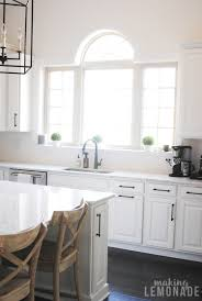 white kitchen cabinet handles and knobs an easy kitchen update that makes a difference