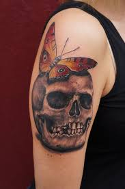 skull with butterfly by graynd tattooimages biz