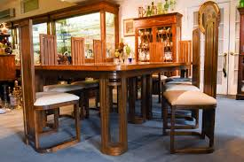 frank lloyd wright style dining table with twelve matching chairs