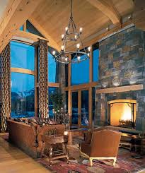 timber frame great room lighting timber frame home cathedral ceiling great room stone fireplace