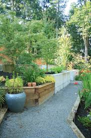 curved wood retaining wall landscape modern with steep slope wood