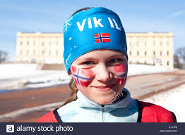 Flag Of Oslo Norwegian With Norwegian National Flag Painted On Face At