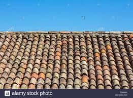 traditional old roof tiles on mediterranean houses as texture