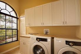 contemporary laundry room with arched window u0026 built in bookshelf