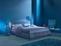 bedroom blue bedroom interior floor lamp blanket oak flooring