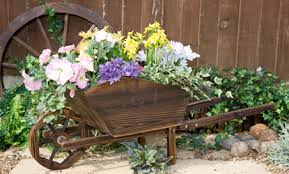 Wooden Wheelbarrow Planter by Wheelbarrow Planter Wood Garden Panter
