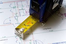 House Floor Plan Measurements A Tape Measure Slightly Open Lying On Top Of A House Floor Plan