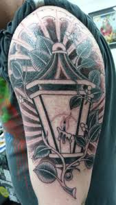 sun rays and lantern on left half sleeve